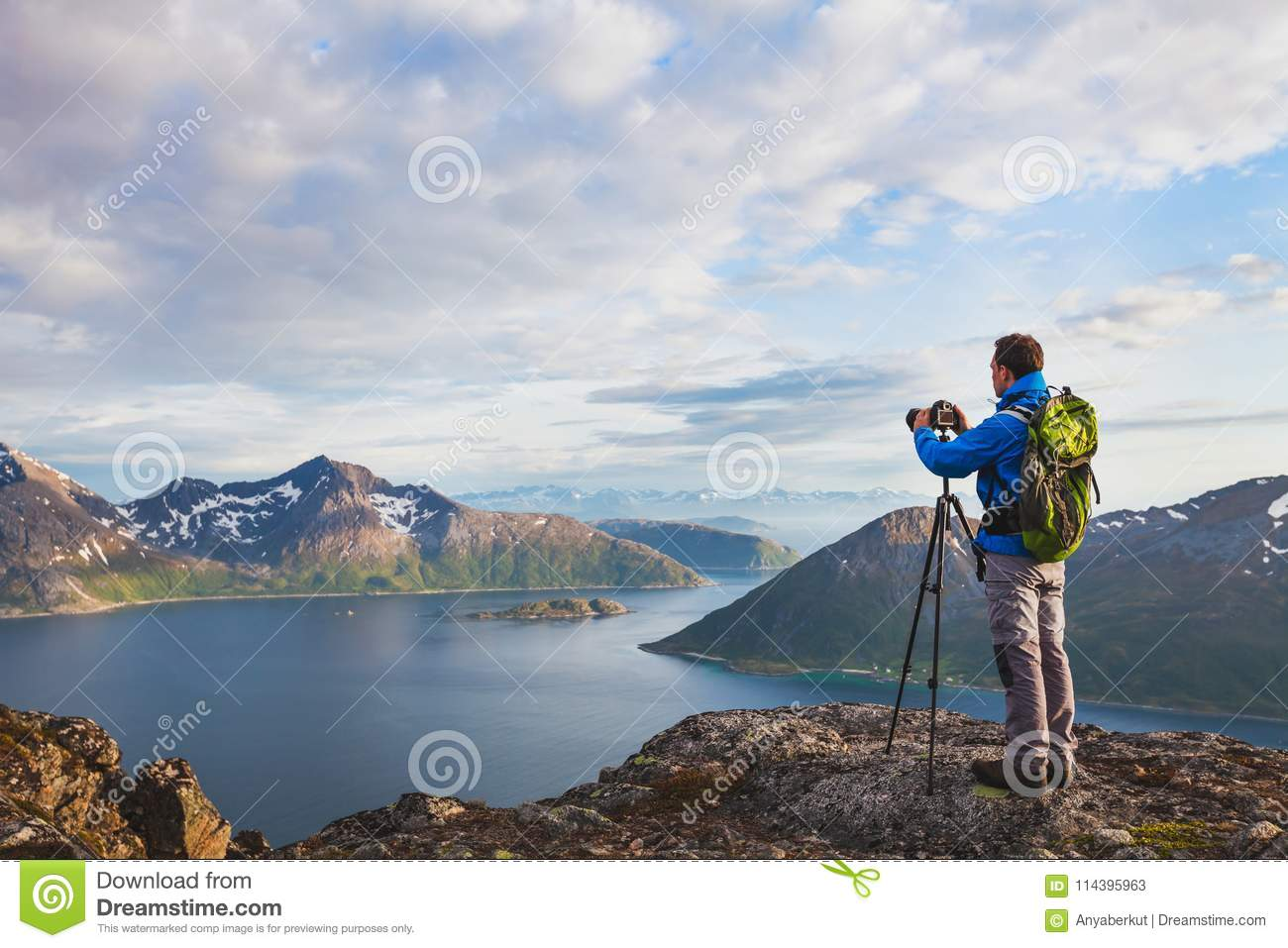 Landscape photographer working with tripod and dslr camera