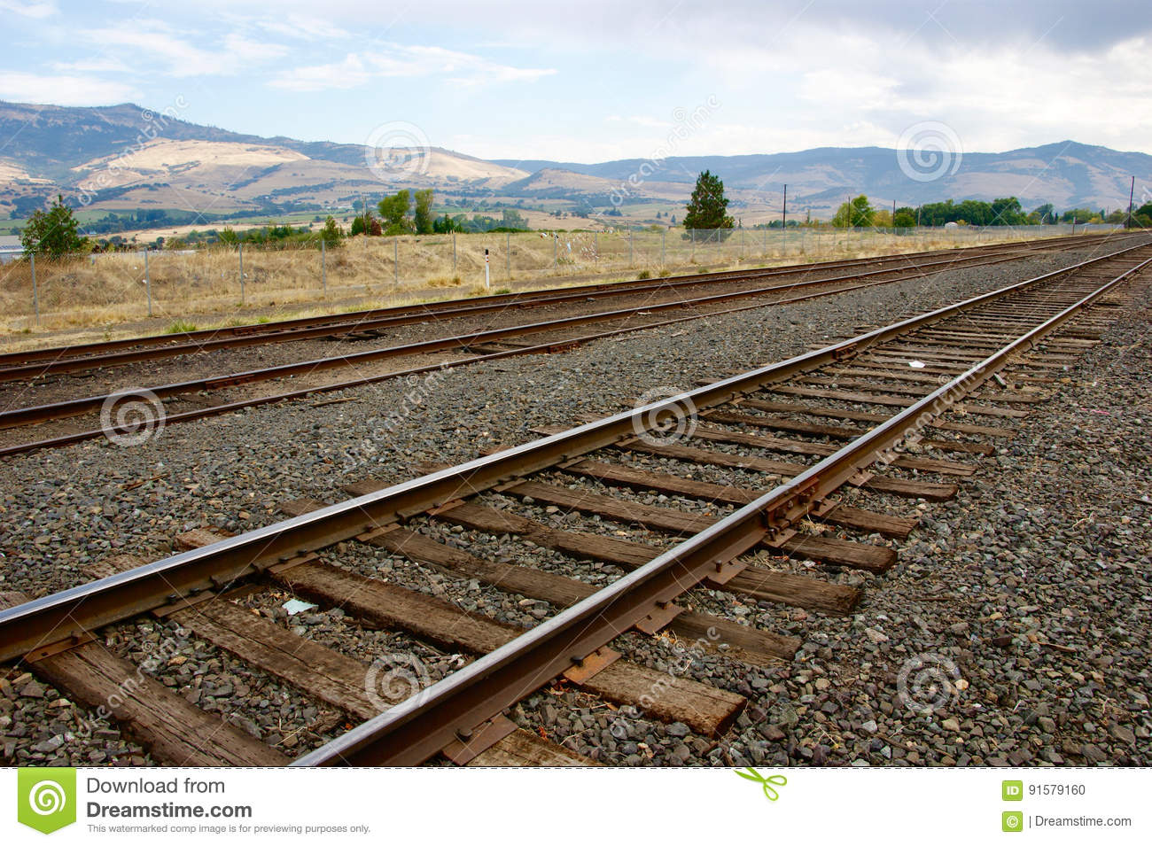 Landscape With A Railroad Track And Mountains In The
