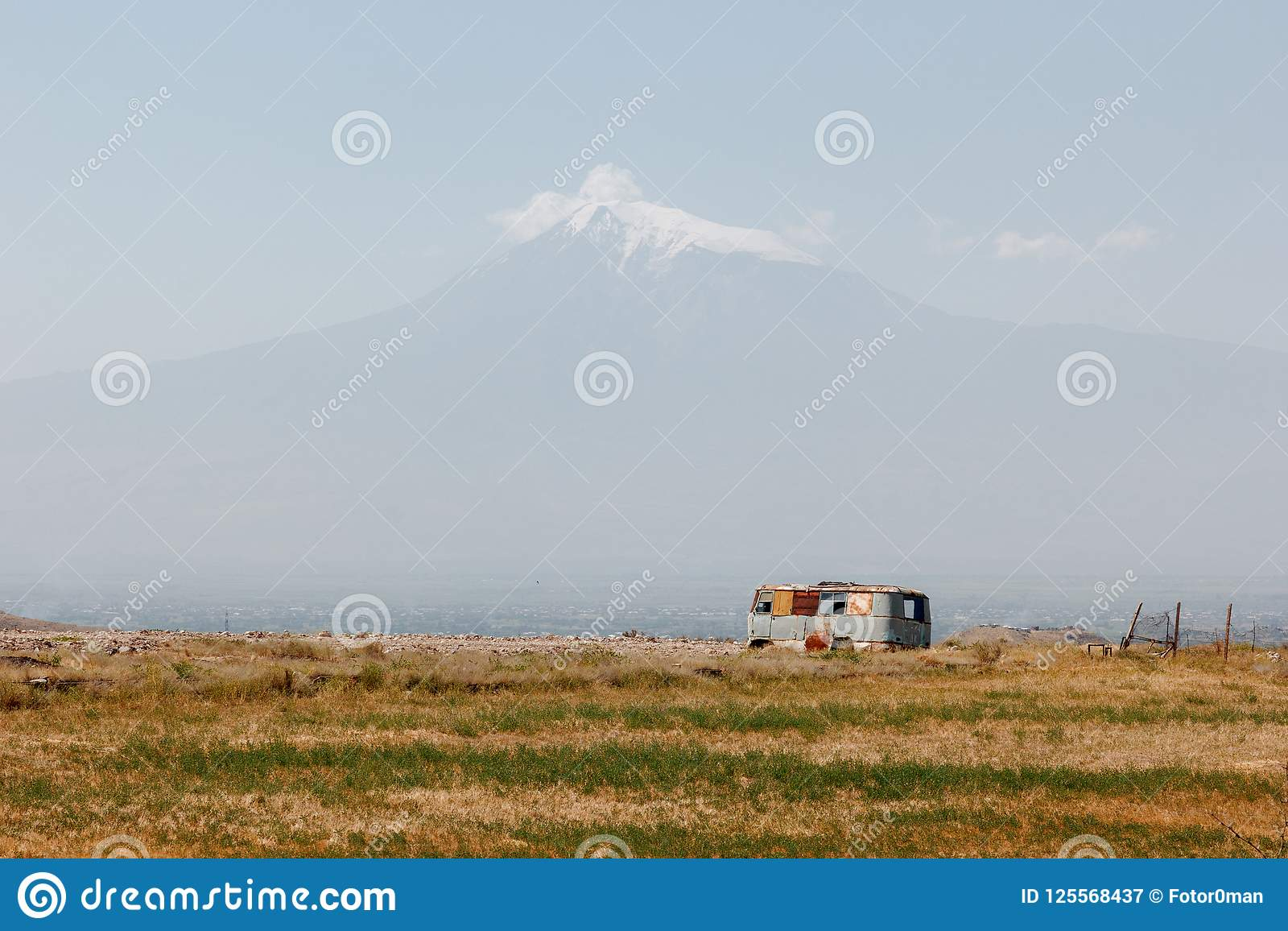 landscape with Mount Ararat and an old rusty abandoned bus