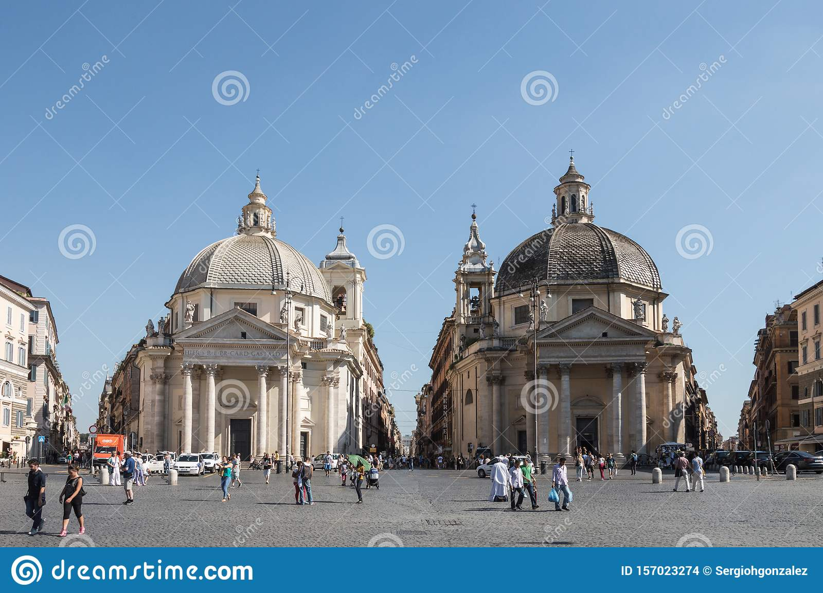 Saint Mary in Montesanto and Chiesa di Santa Maria dei miracoli churches facades crowded with tourists in a sunny day