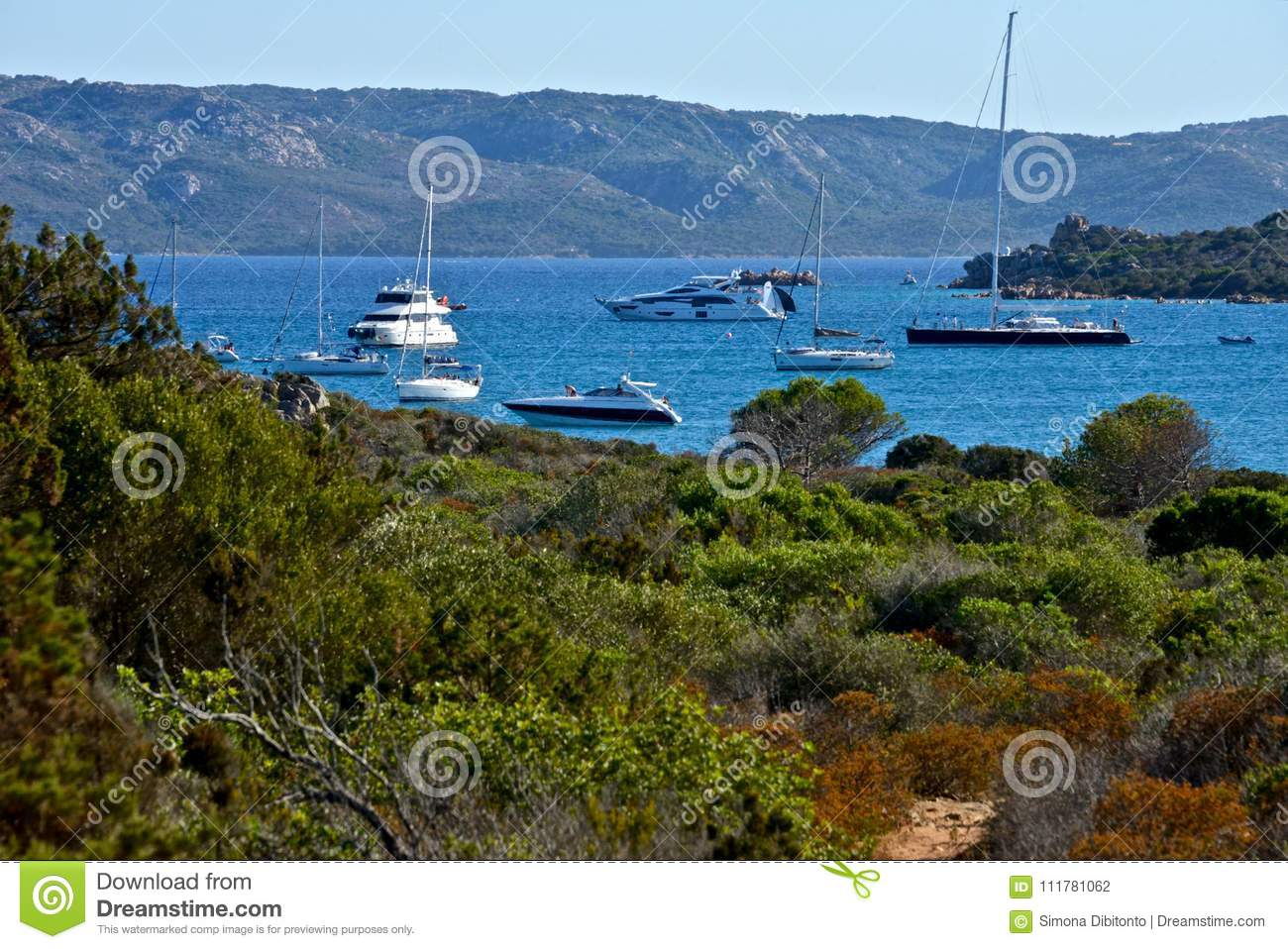 Landscape of wild nature with some yachts moored in the middle of the sea