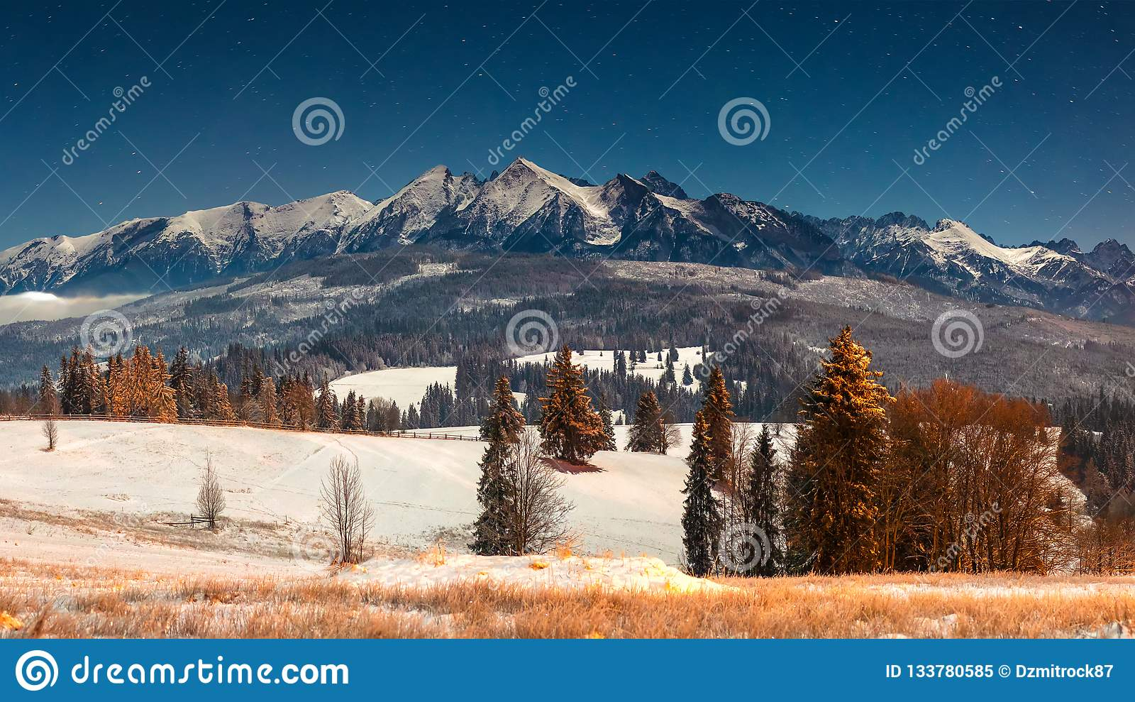Landscape of winter mountains at night