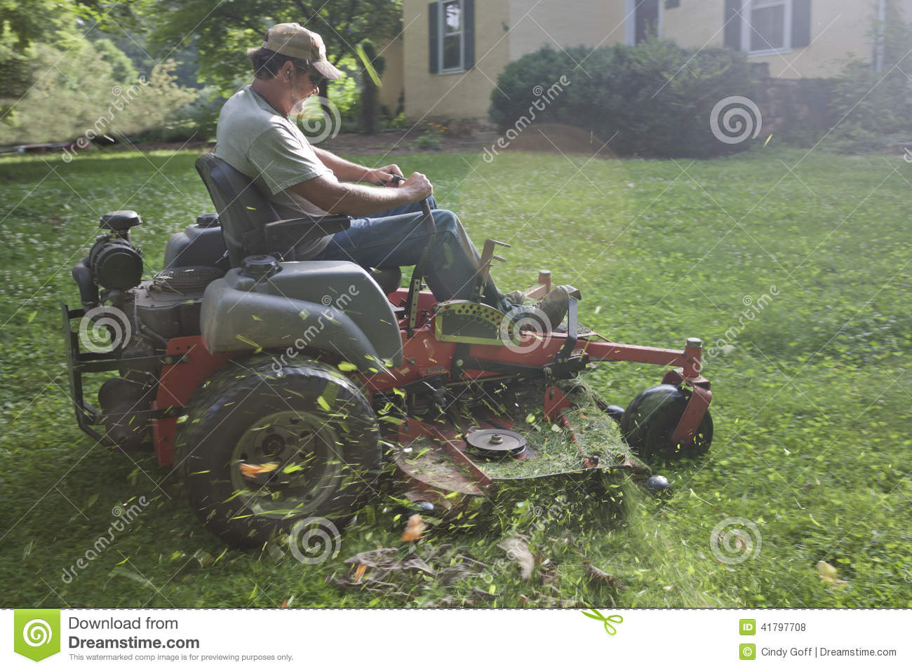 Landscaper on riding lawn mower stock photo image 41797708 for Lawn mower cutting grass