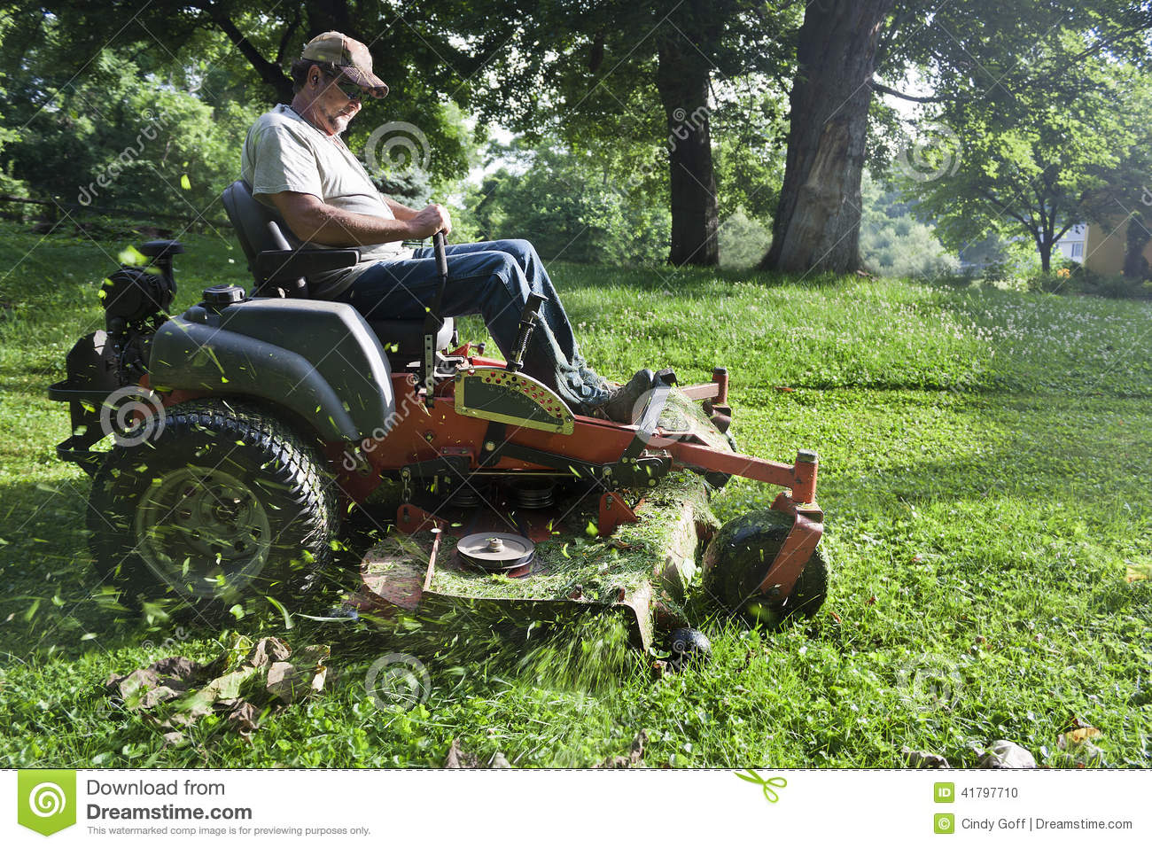Landscaper on riding lawn mower stock photo image 41797710 for Lawn mower cutting grass