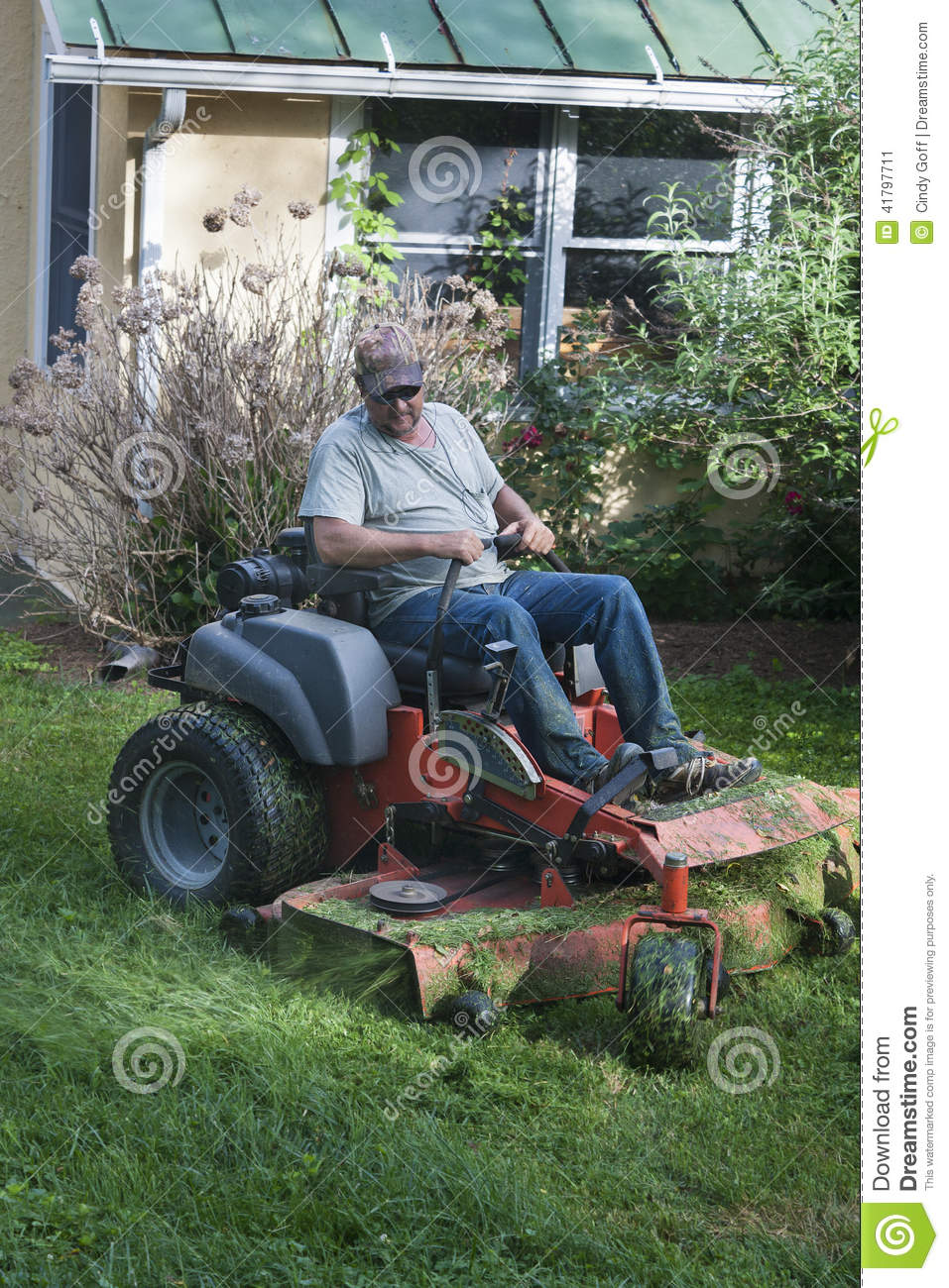 Landscaper on riding lawn mower stock photo image 41797711 for Lawn mower cutting grass