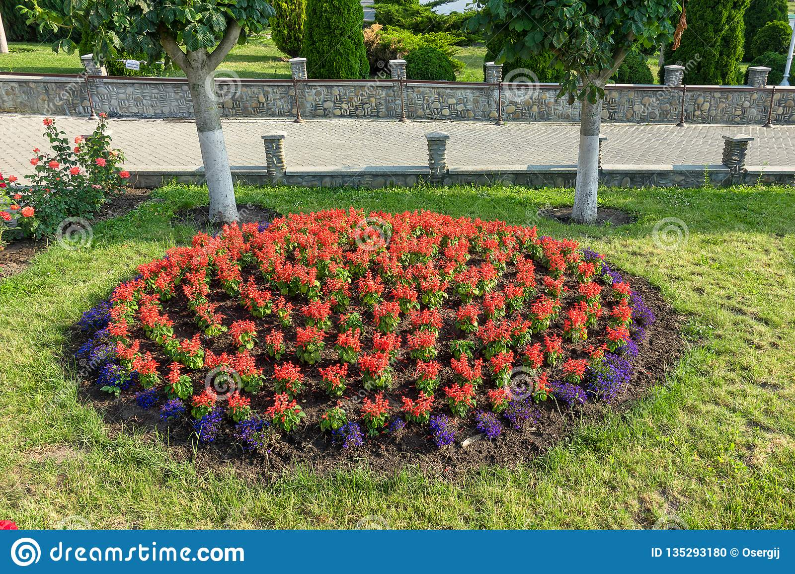 Landscaping Flower Beds. Summer Sunny Day.