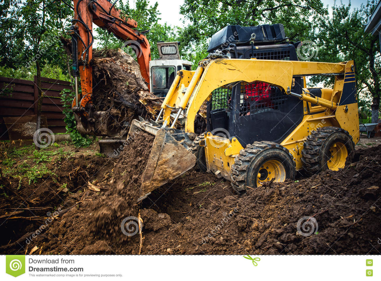landscaping works with bulldozer and excavator at home