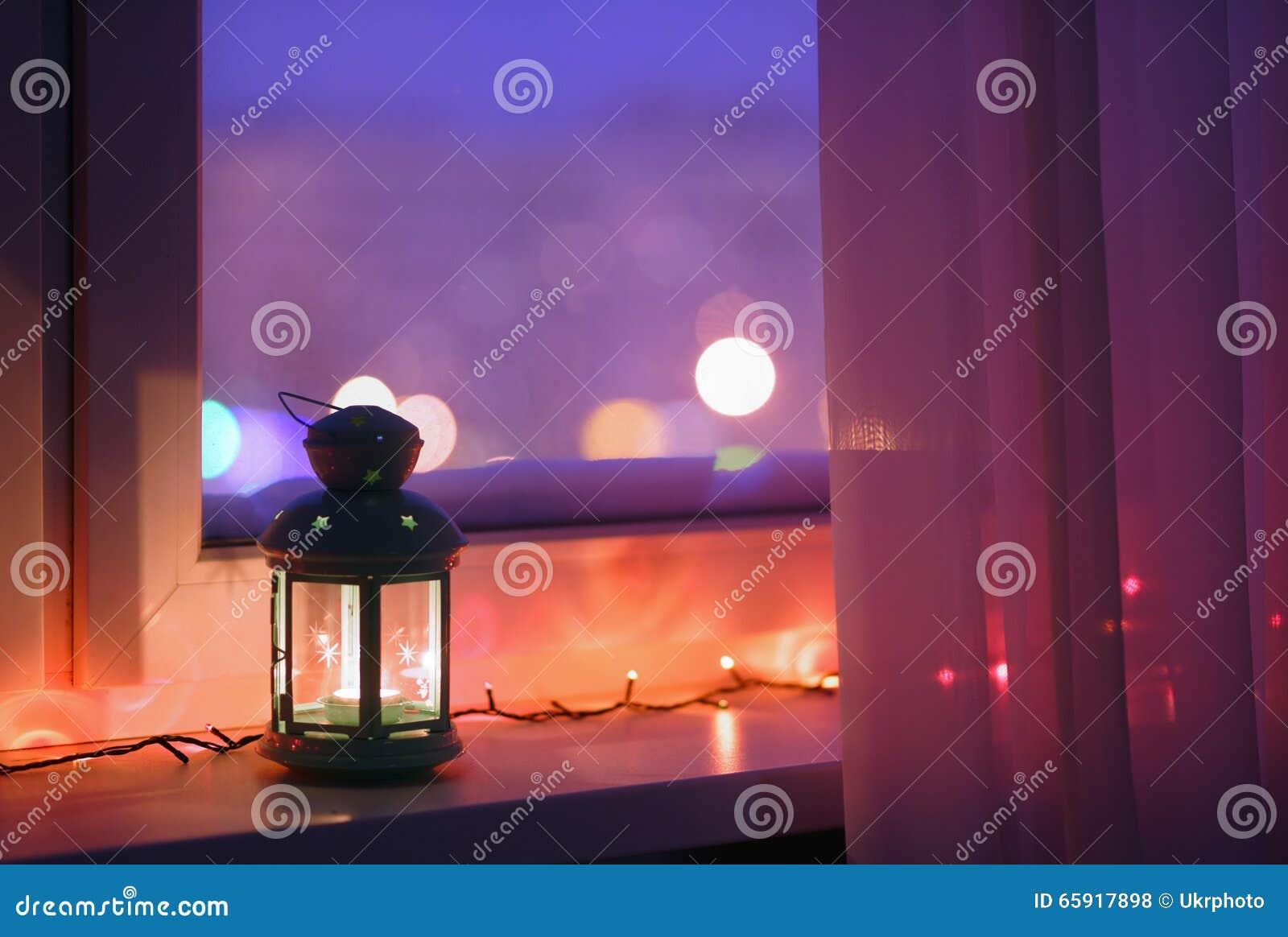 Lantern on a window sill stock photo image 65917898 - Christmas window sill lights ...