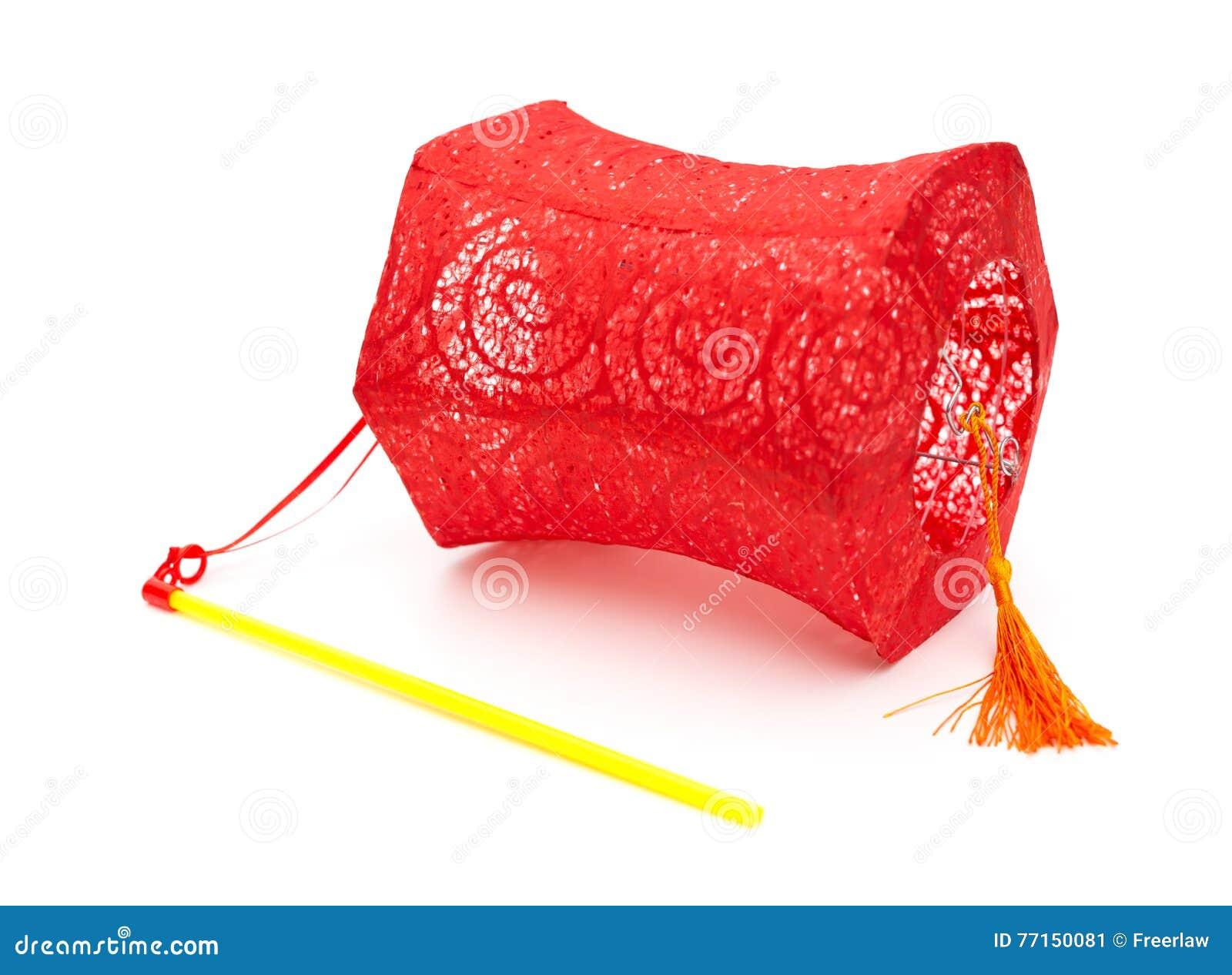 Lanterne rouge avec la poignée sur le fond blanc