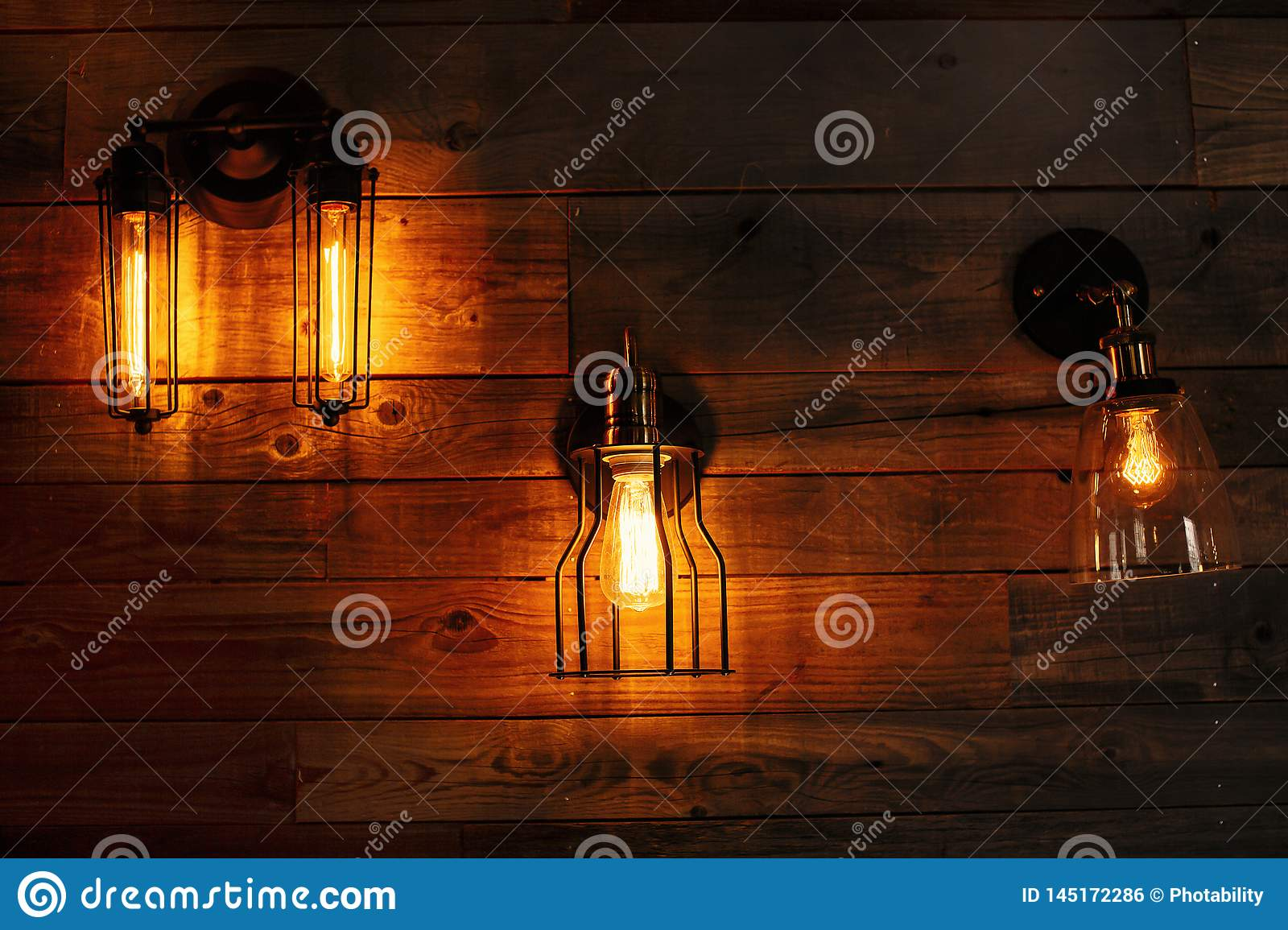 Lanterns on a wooden wall