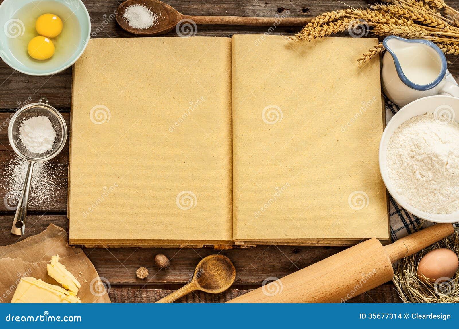 Lantliga ingredienser för kökbakningkaka och den tomma kocken bokar