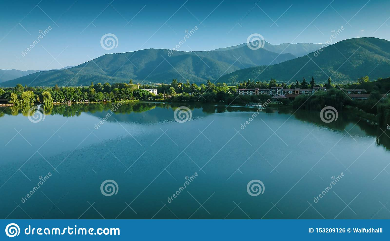 Lapota lake with mountains reflections located in Georgia country. Great place for vacation traveller.