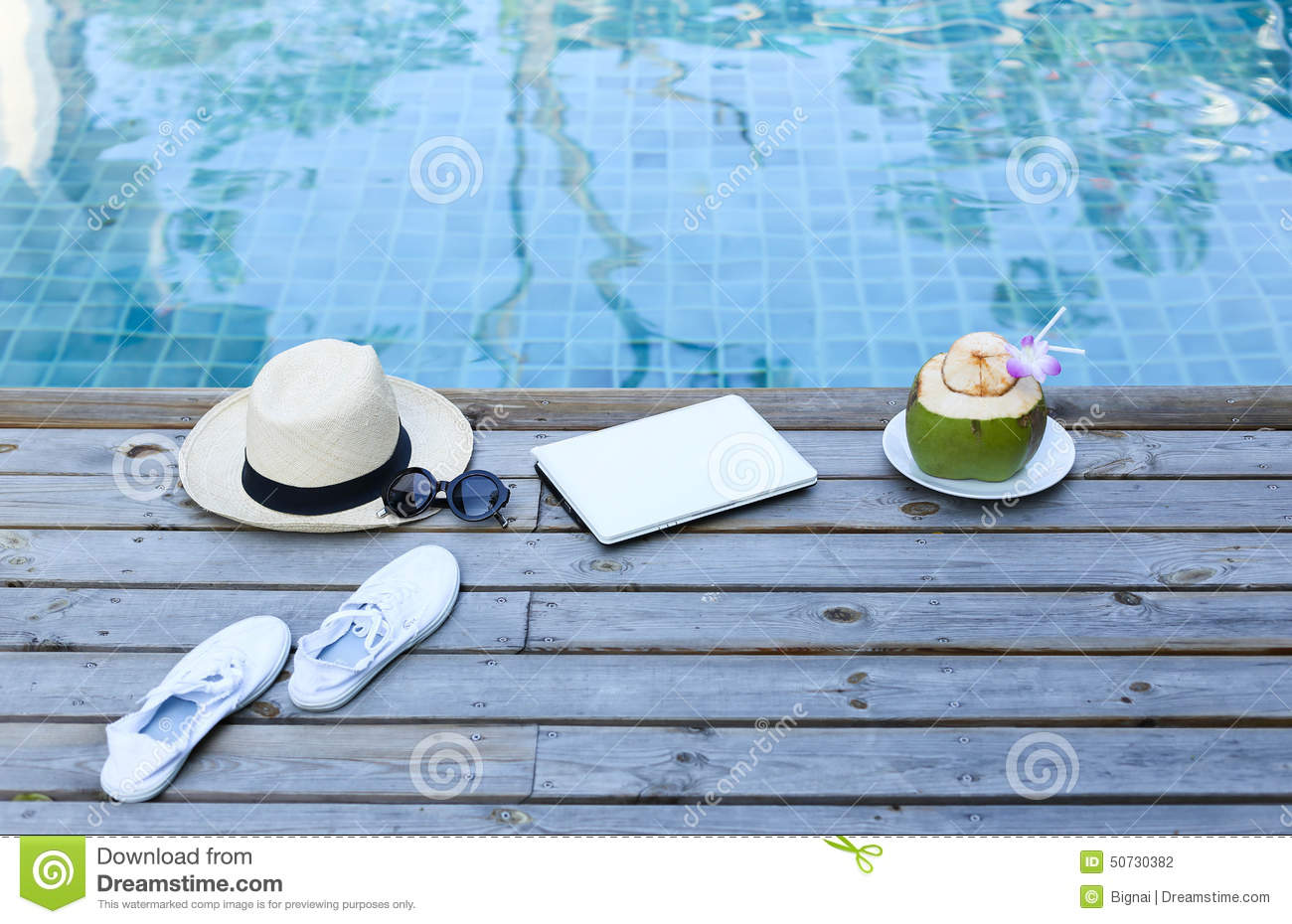 Laptop And Coconut Drink By Awimming Pool Stock Photo Image 50730382
