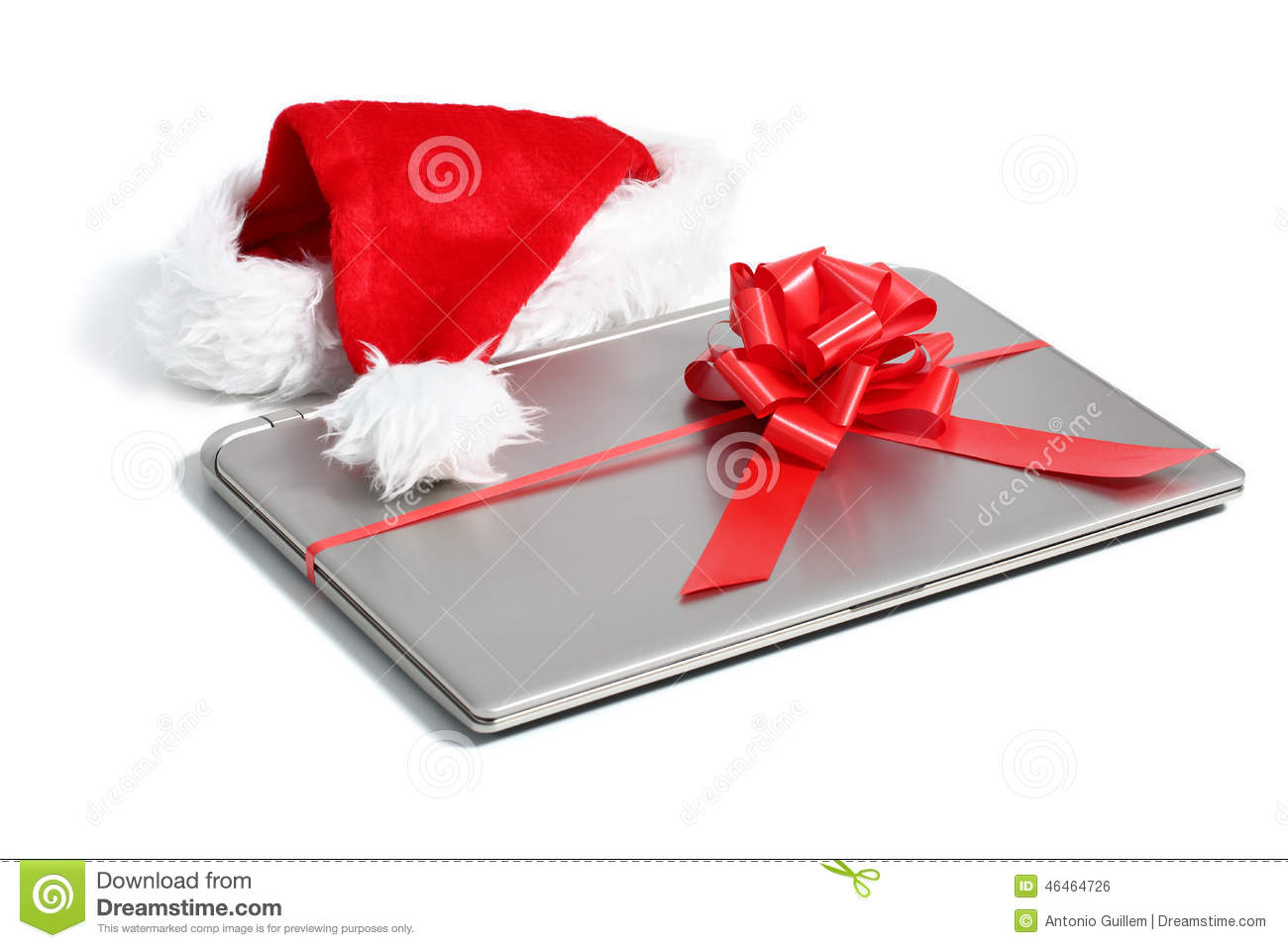Laptop computer christmas gift with a ribbon stock photo for Pc in regalo gratis