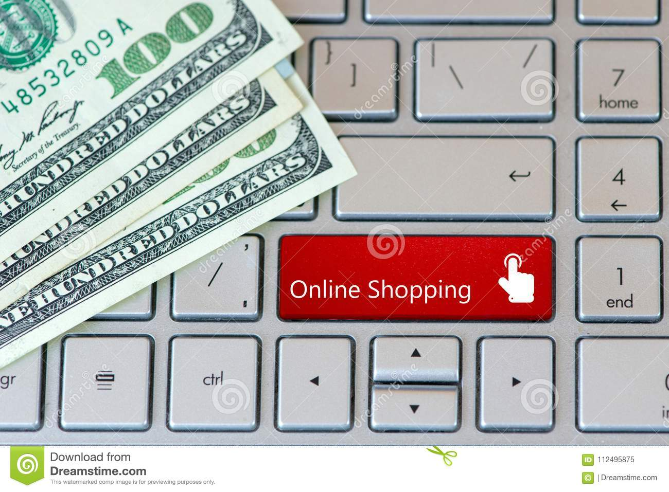 Laptop keyboard with dollar banknotes and red button - Online Shopping