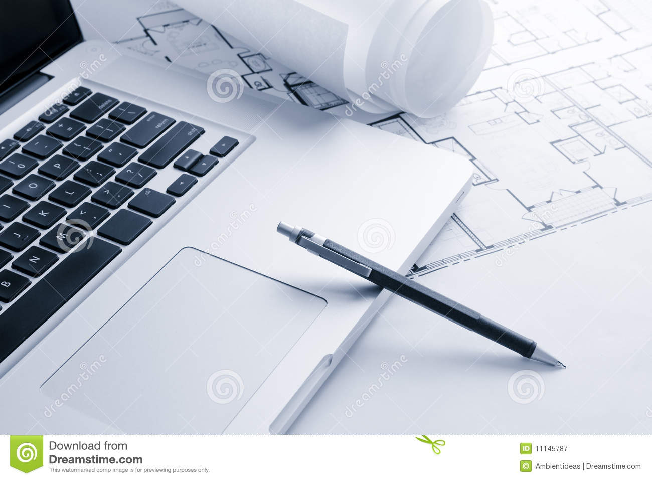 Laptop With Mechanical Pencil On Blueprints Royalty Free