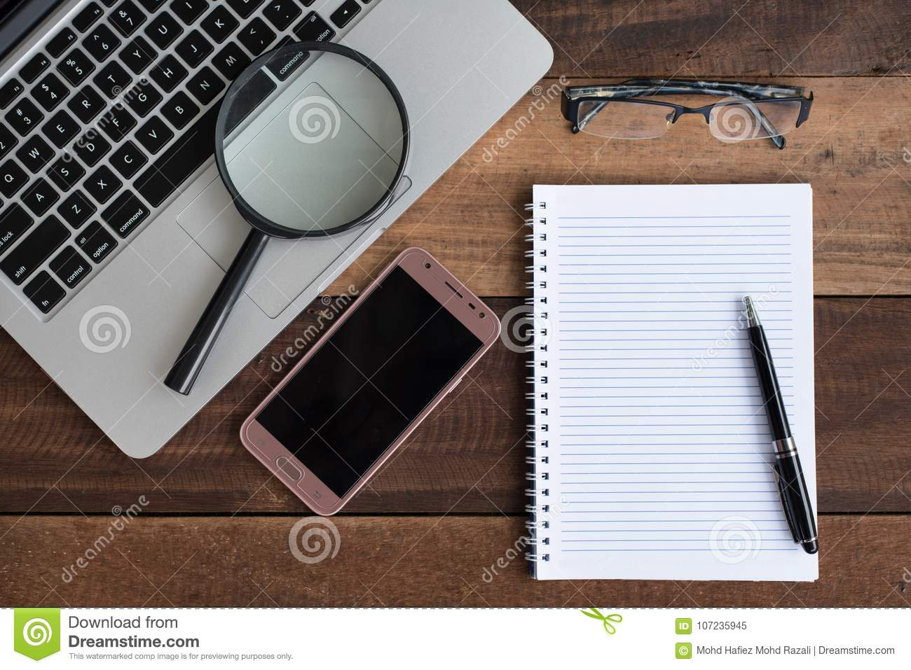 Laptop, Notebook, Smartphone, Spectacle And Magnifying Glass