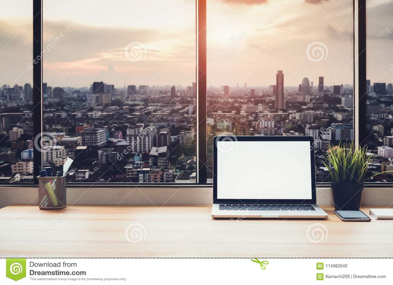 Laptop on table in office room on window city background, for graphics display montage.