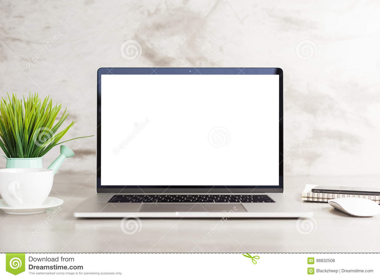 Laptop white blank screen on work table front view