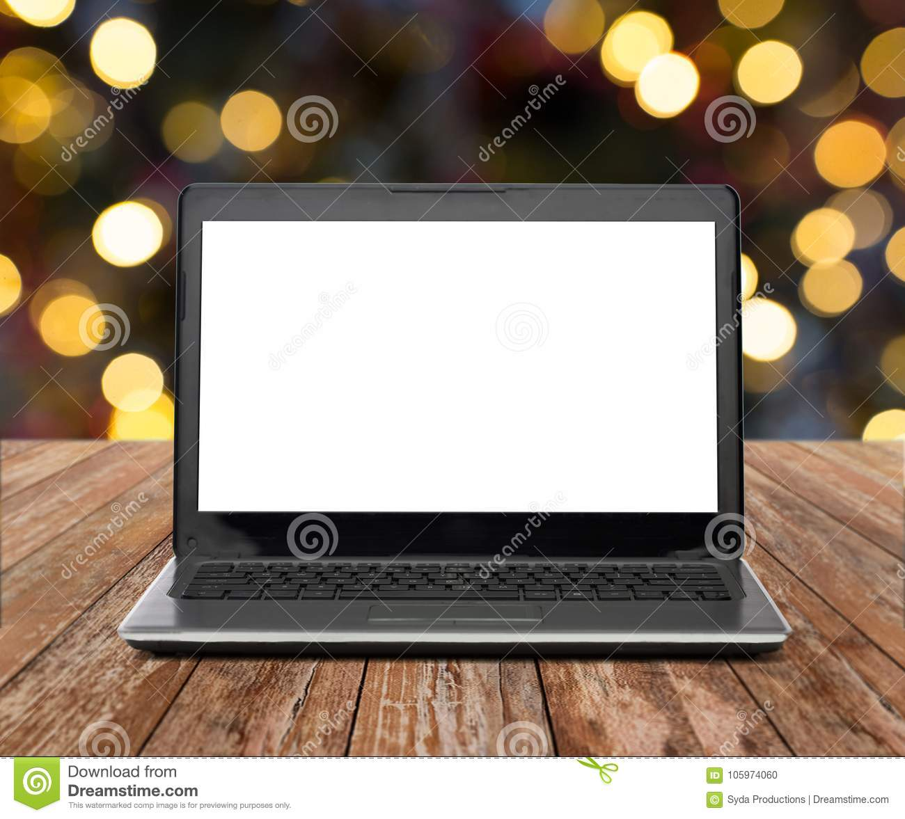 technology and advertisement concept laptop computer with blank white screen on wooden table over christmas lights background