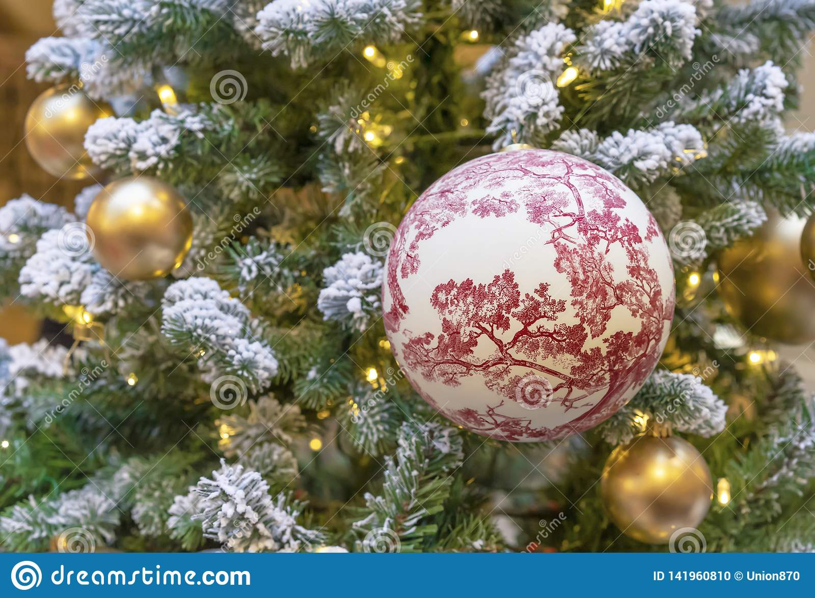 Large ball with floral ornaments on the Christmas tree