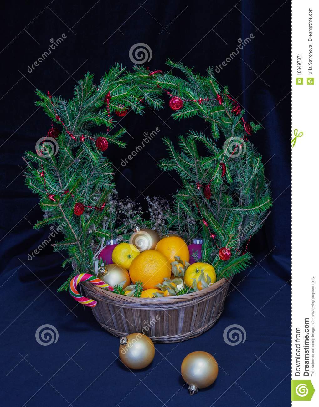 a large basket of fruit and christmas balls crowned wreath of s - Large Christmas Balls