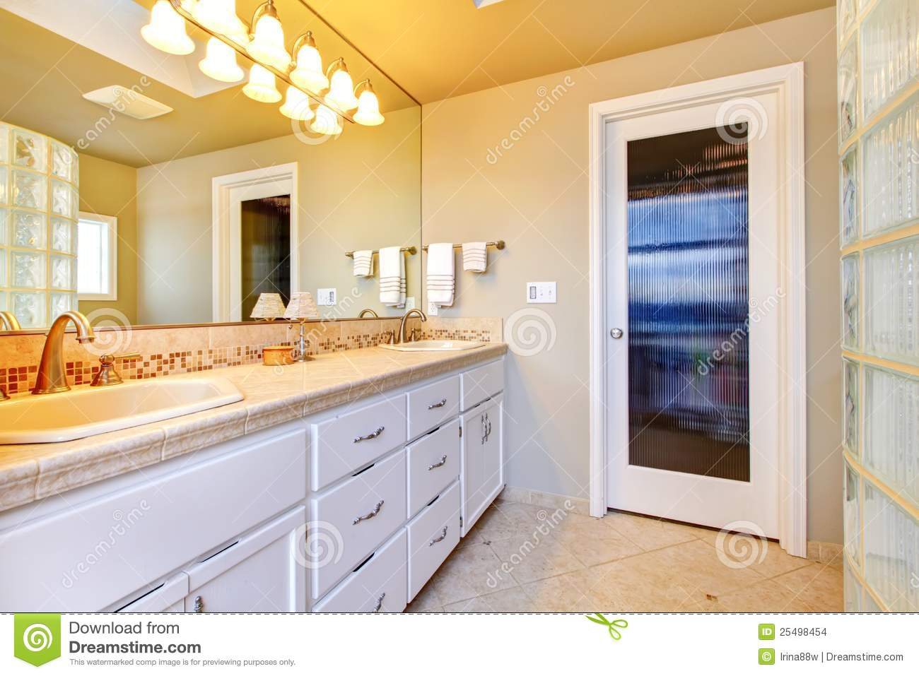 large bathroom with white cabinets stock images image