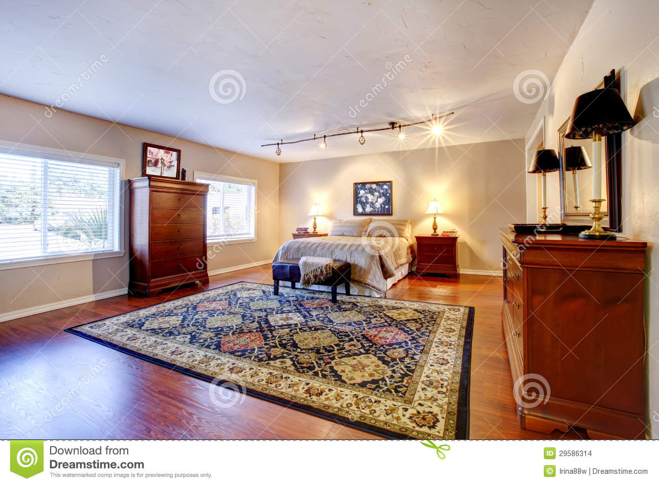 Large Bedroom With Hardwood Floor And Two Dressers. Stock Images ...