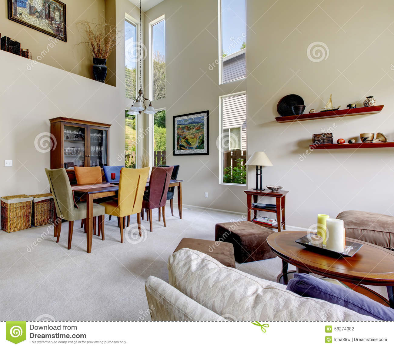 Large beige bright living room with dining room table with for Grande table salle a manger