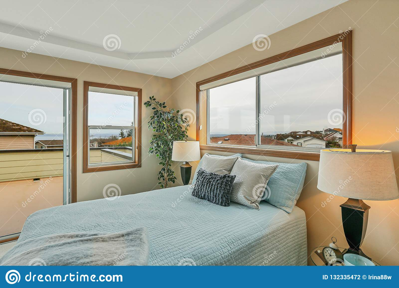 Large Beige Master Bedroom With Blue Bedding Stock Photo Image Of Comfortable Clean 132335472