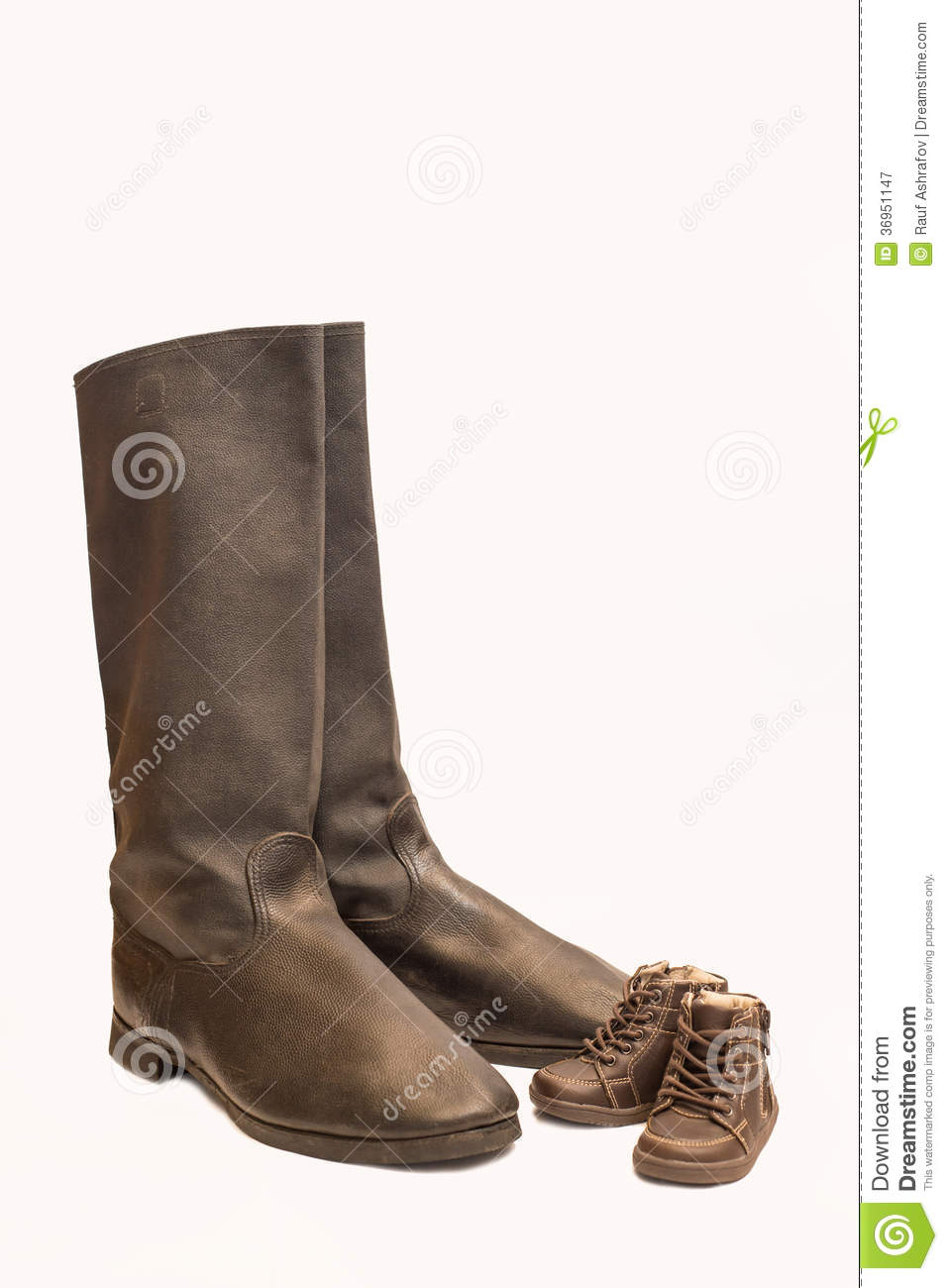 large boots and small shoes royalty free stock photography