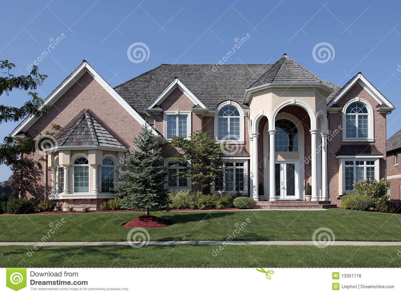 Large Brick Home With Columned Entryway Stock Photo