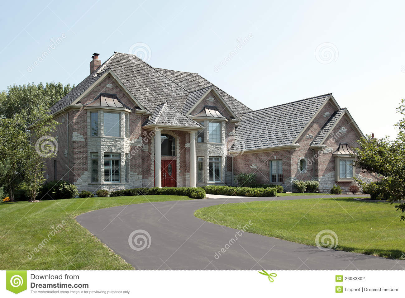 Large Brick Home With Red Door Stock Photography Image