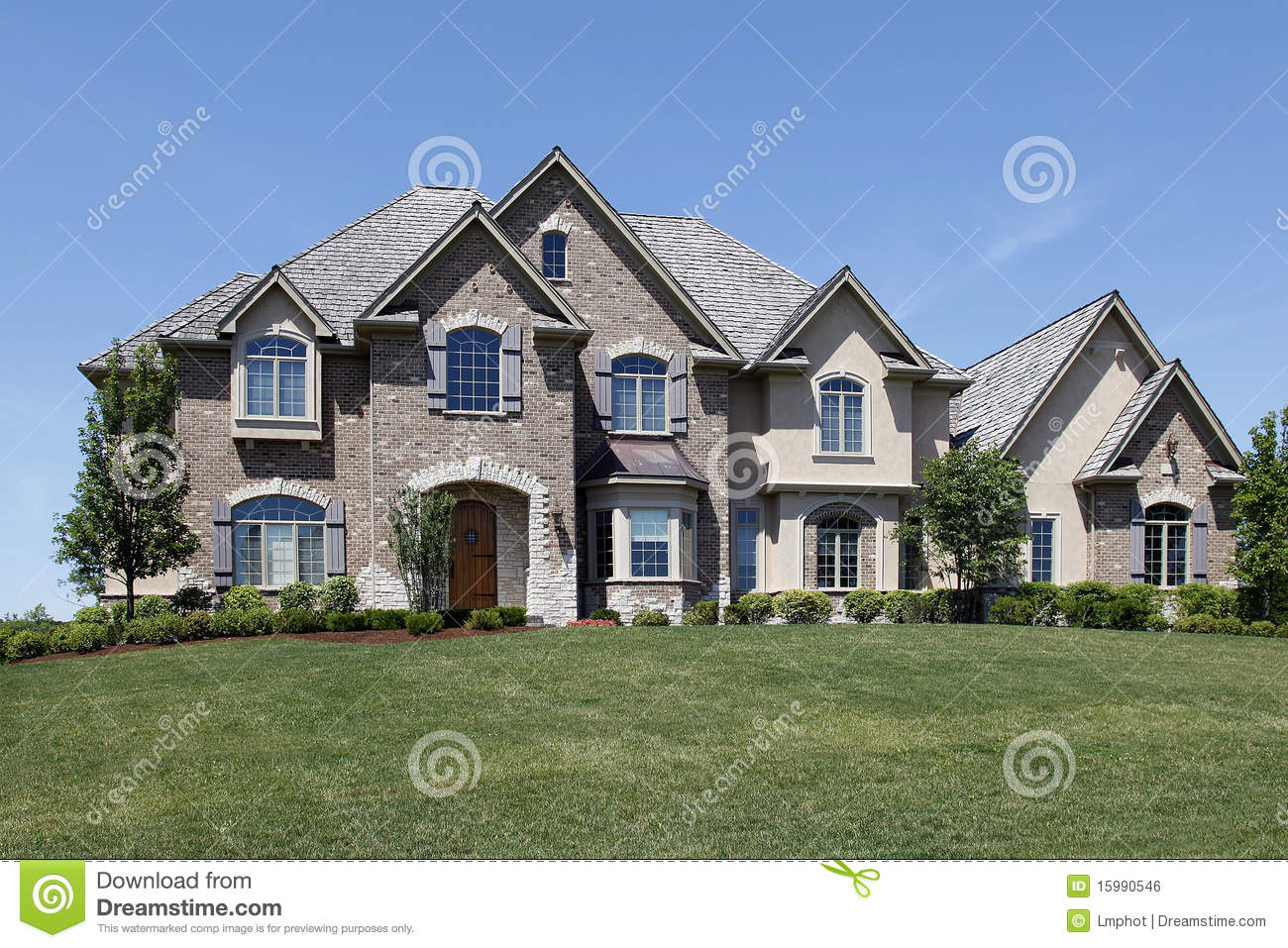 Large Brick Home With Stone Entry Royalty Free Stock Image