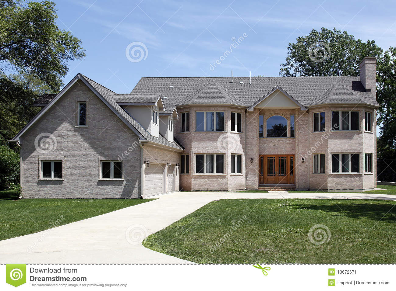 Large brick home with three car garage stock image image for 3 car garage homes