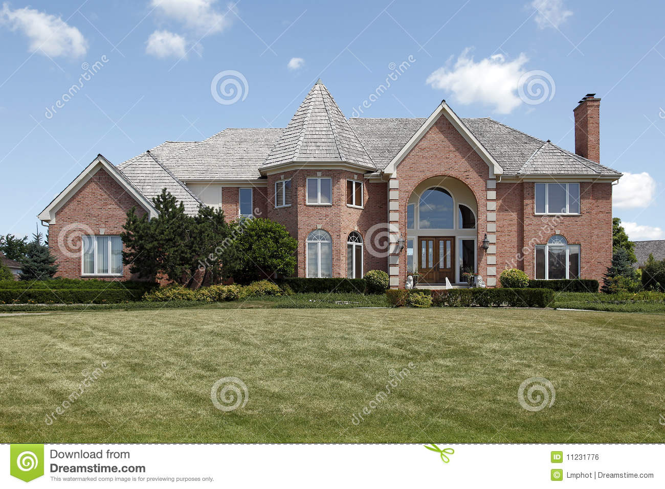 Large Brick Home With Turret Stock Photo - Image of