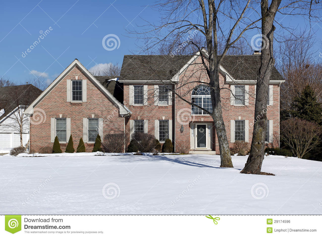 Large brick home in winter