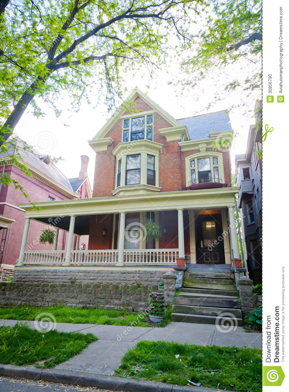 Large brick victorian style home stock photo image 30856790 for Brick victorian house