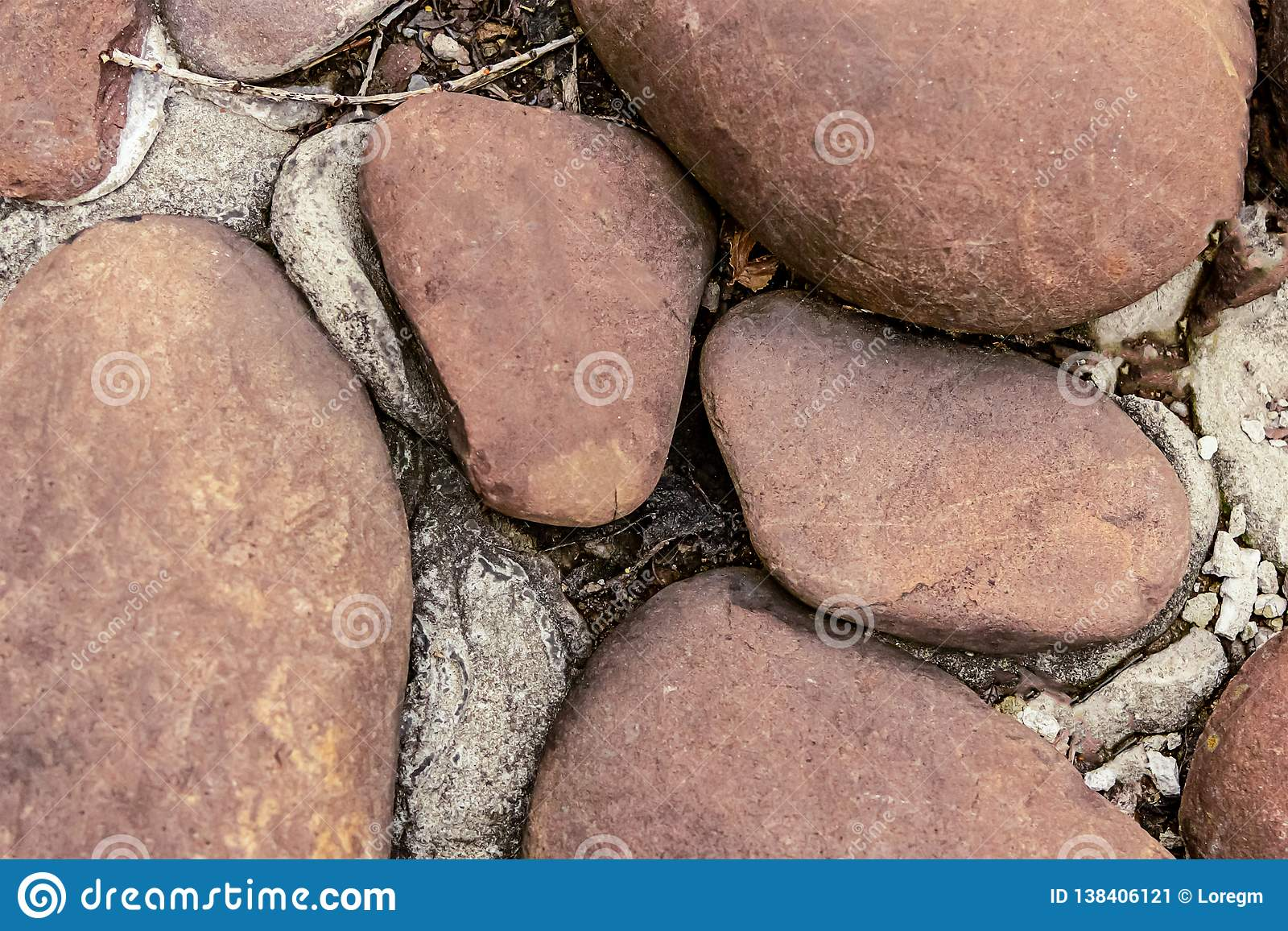 Large brown cobblestone garden decor close-up stone background base design grunge style hard natural