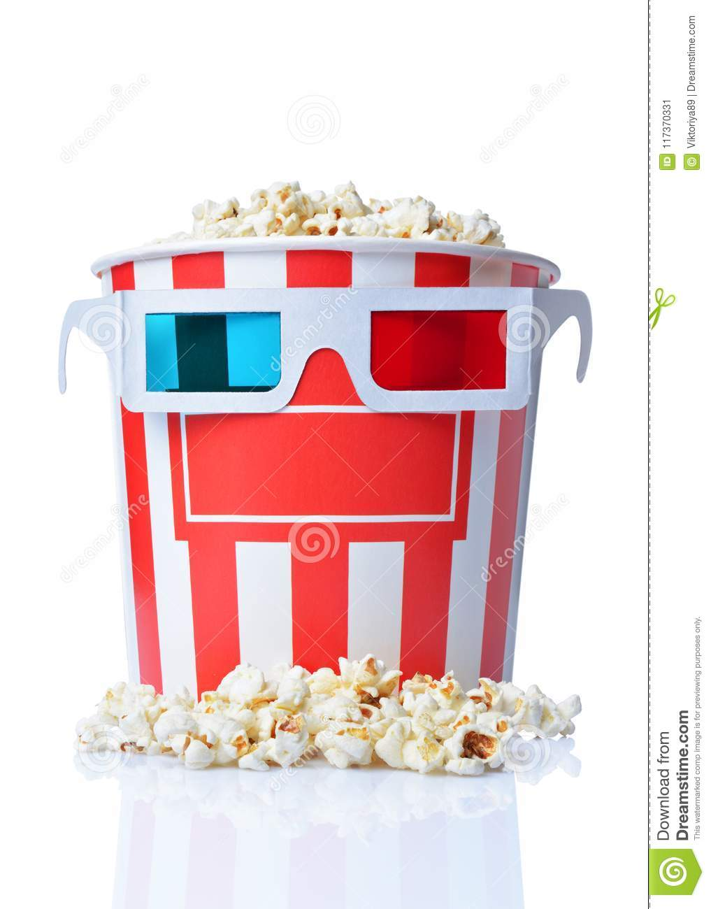 Large bucket of appetizing salty popcorn with 3d anaglyph glasses