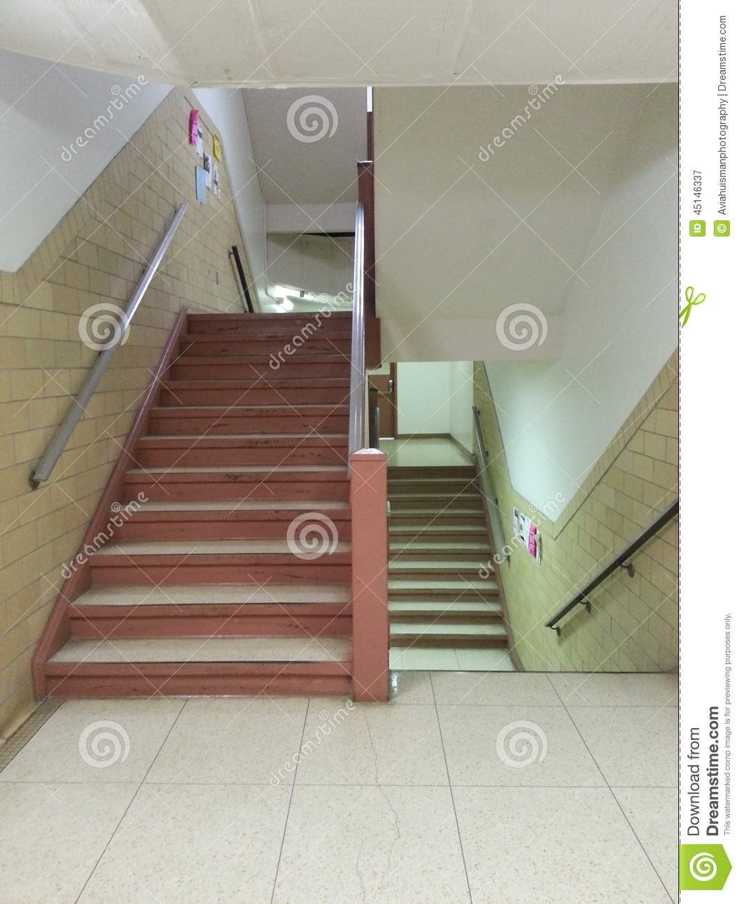 Stairwell In A Large Public Bulging With Stairs Going Up And Down To Other  Floors. The Floor Is Covered In Linoleum Ant There Are Handrails For Safety.