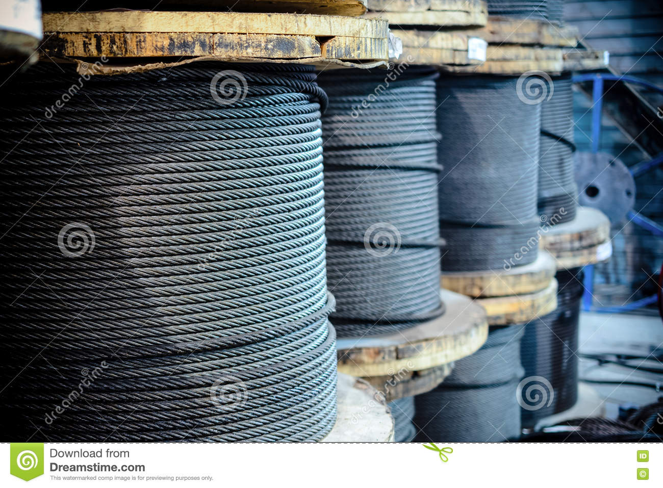 Large cable reels stocked in the factory premises.