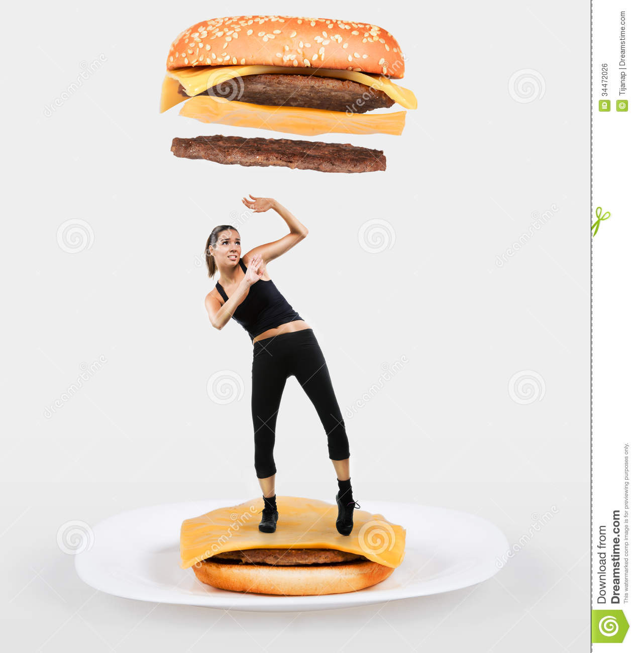 Large cheeseburger falling on a fit woman