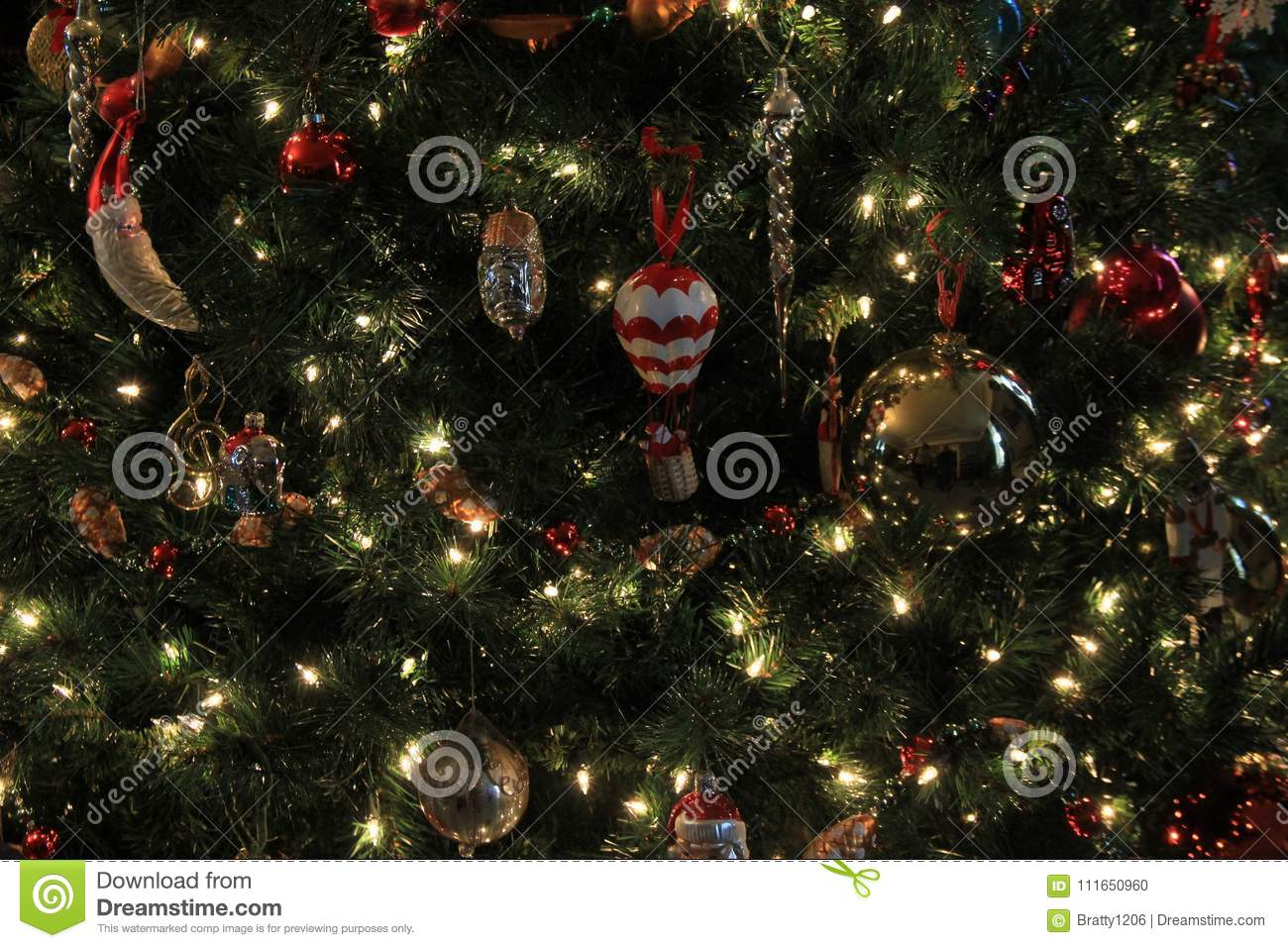 large christmas tree decorated with various ornaments twinking lights throughout branches - Large Christmas Tree Ornaments