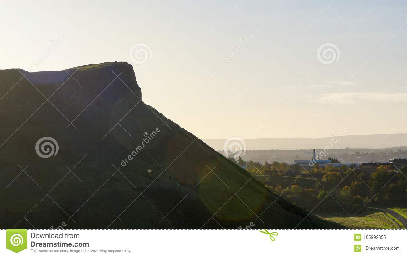 A large cliff with morning sky