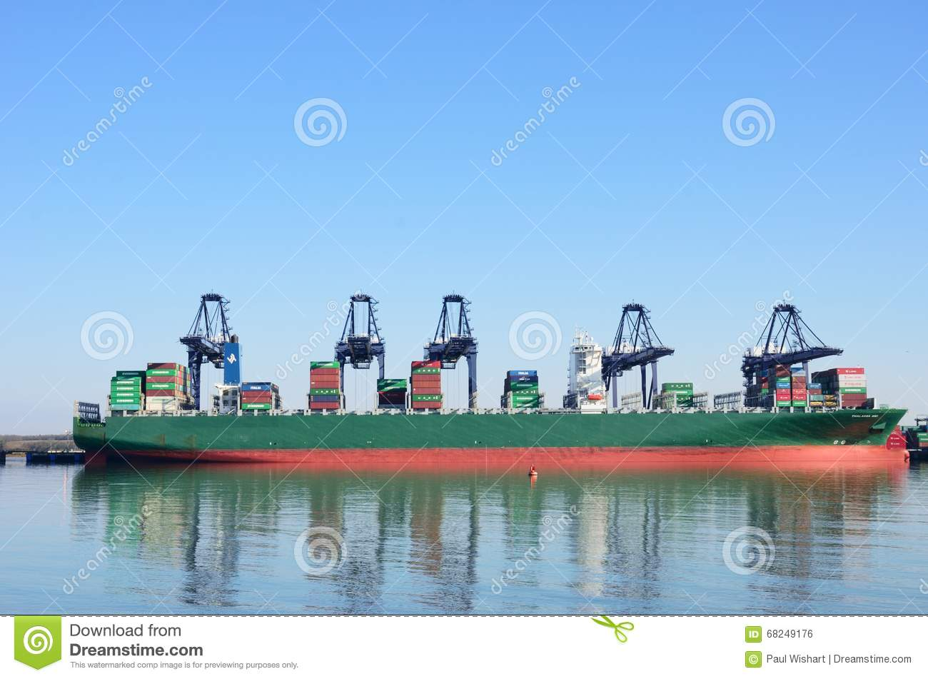 Large Container Ship in port with cranes