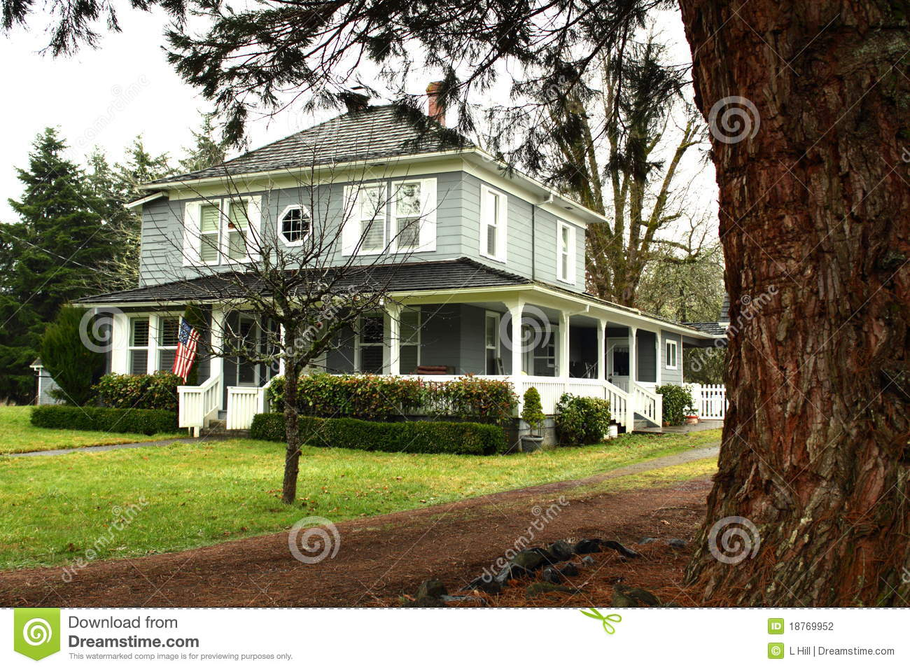 Large Country Home With Wide Wrap Around Porch Stock Photo