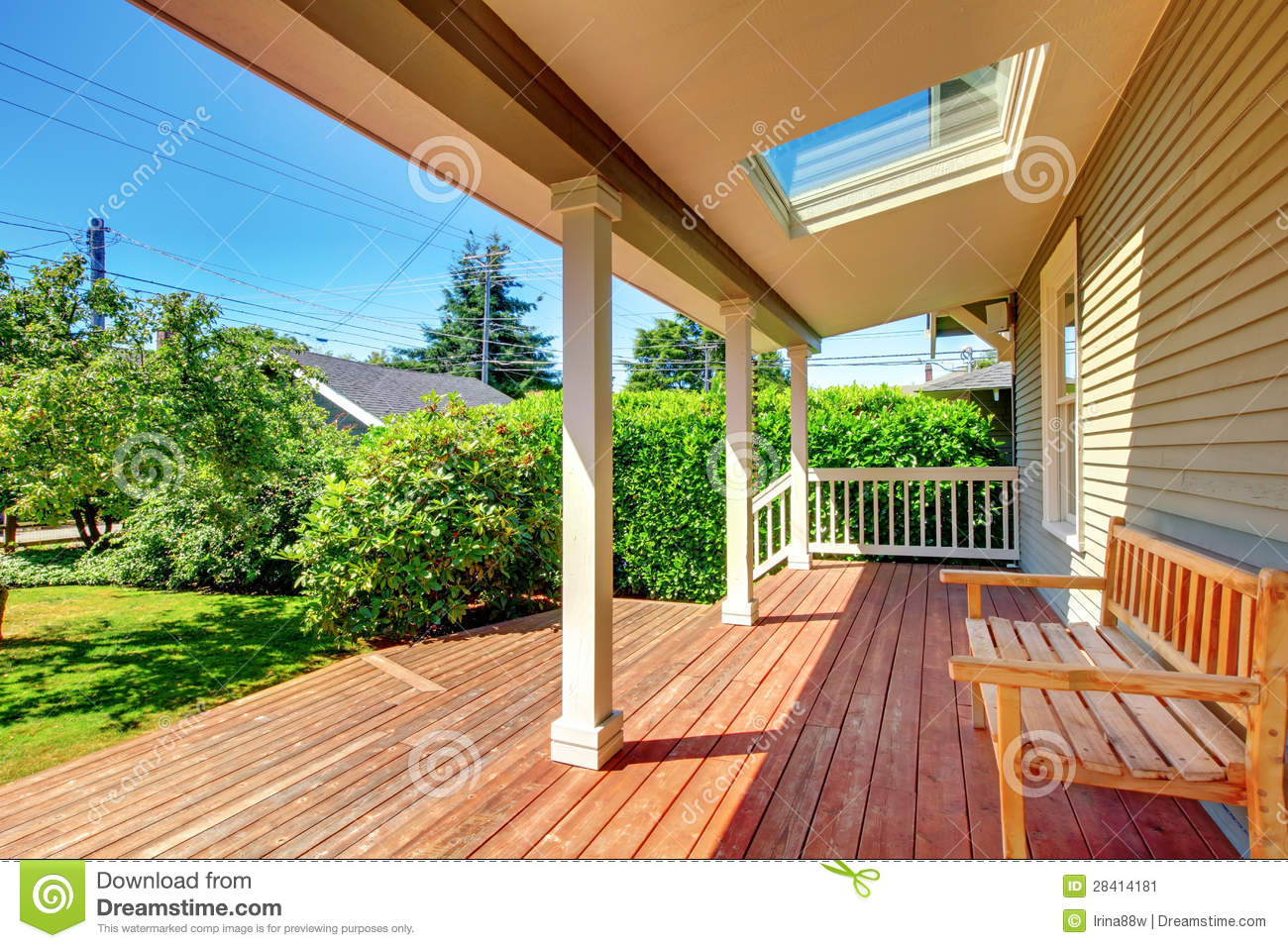 Large covered porch with skylight and wood bench and floor for Large skylights