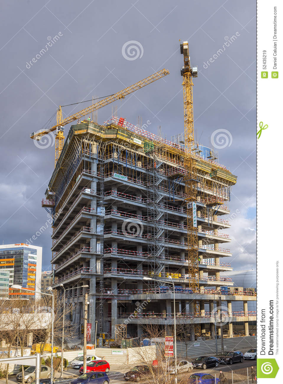 large cranes working in construction site building new