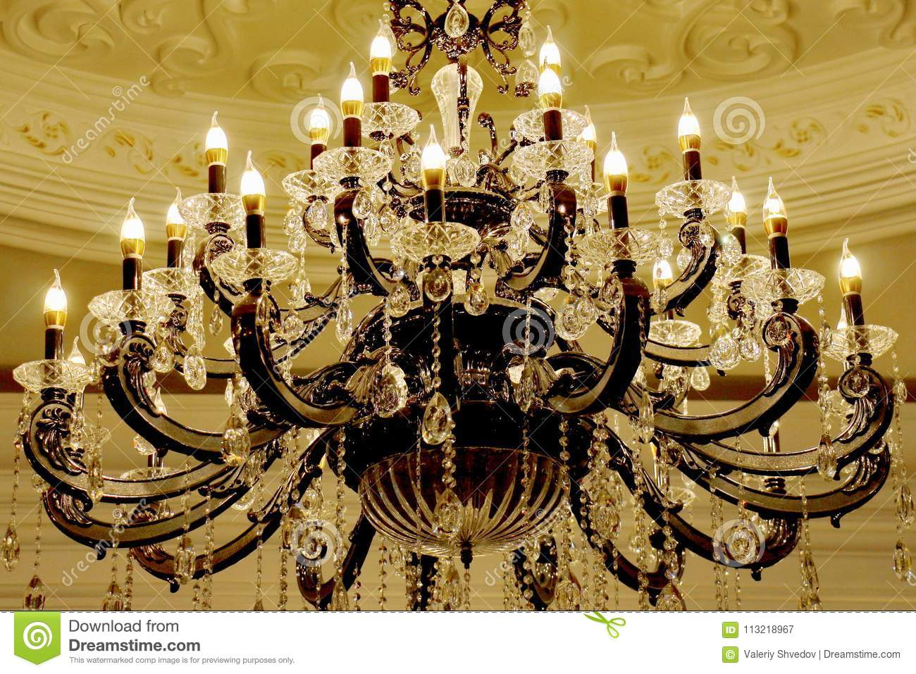Large Beautiful Glowing Chandelier In The Form Of A Set Candles Close Up